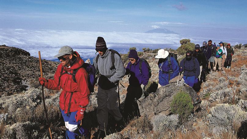 Trekkers above Shira Plateau, Mount Kilimanjaro, Tanzania. Assig