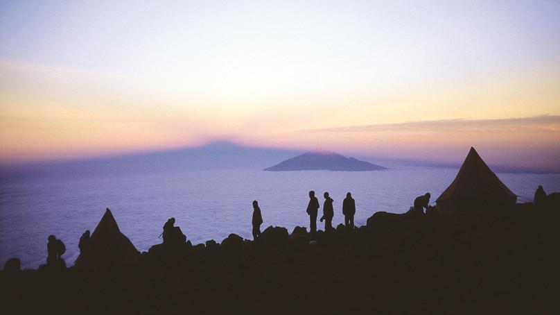 Shadow of Kilimanjaro falling past Mount Meru, from Shira Platea
