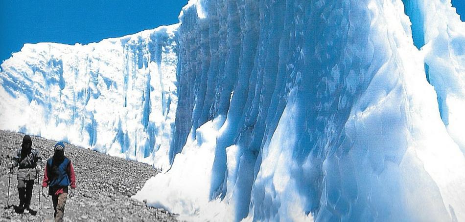 Trekkers-walk-by-the-Furtwangler-glacier-on-Kilimanjaro-e1462417819119