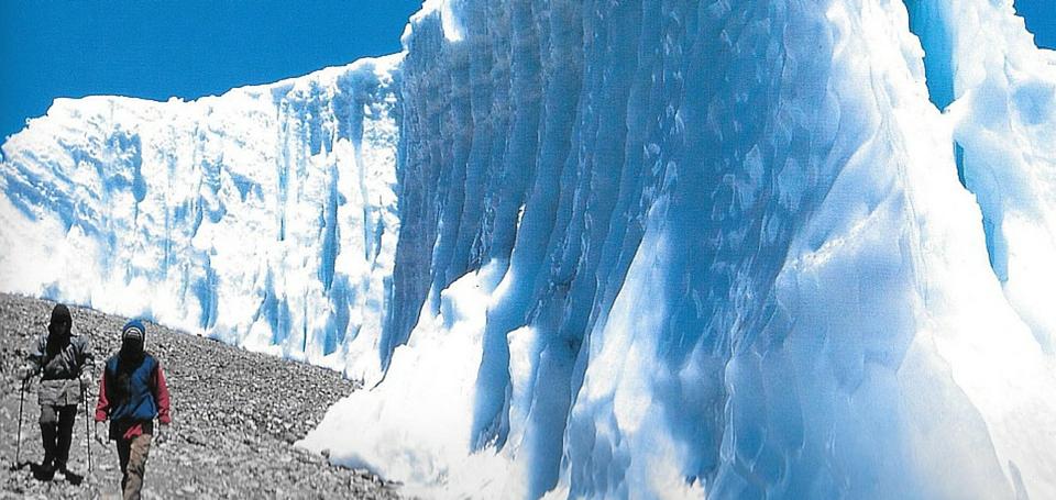 Trekkers-walk-by-the-Furtwangler-glacier-on-Kilimanjaro