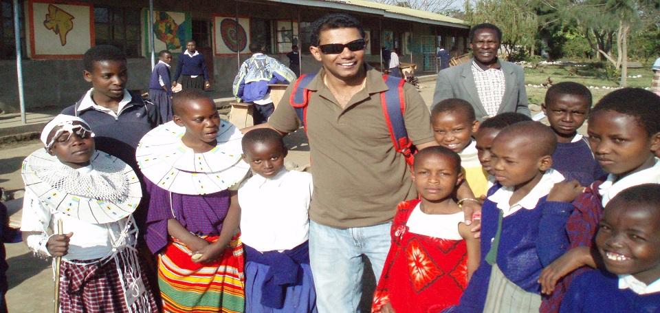 Wanderlust-founder-with-children-of-Olmuringiringa-school-in-Arusha